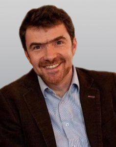 Dr. Emrys Schoemaker